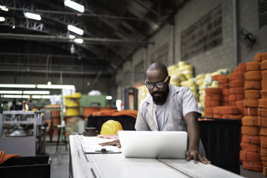 Man looking at plans in a warehouse