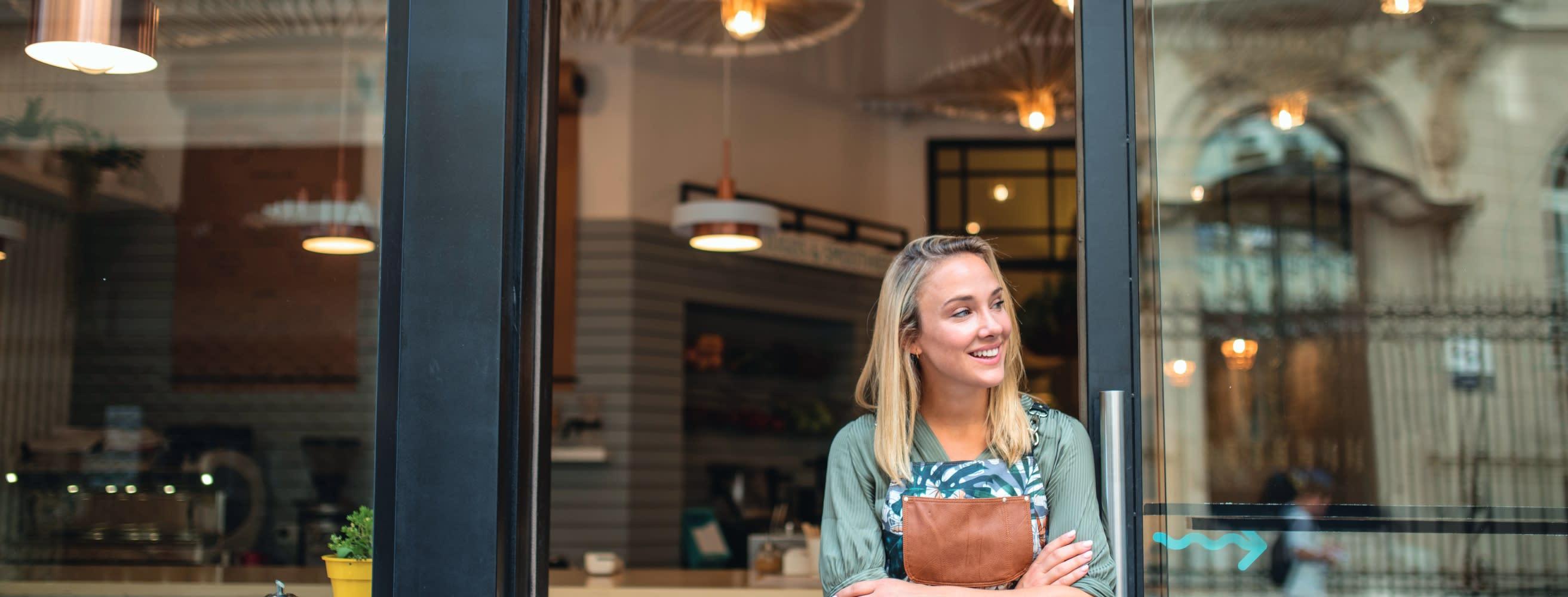 Woman in cafe doorway