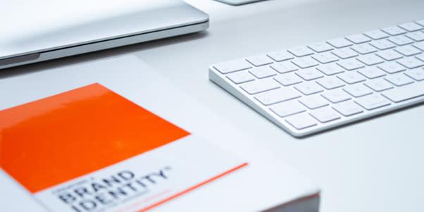 Brand identity book and keyboard