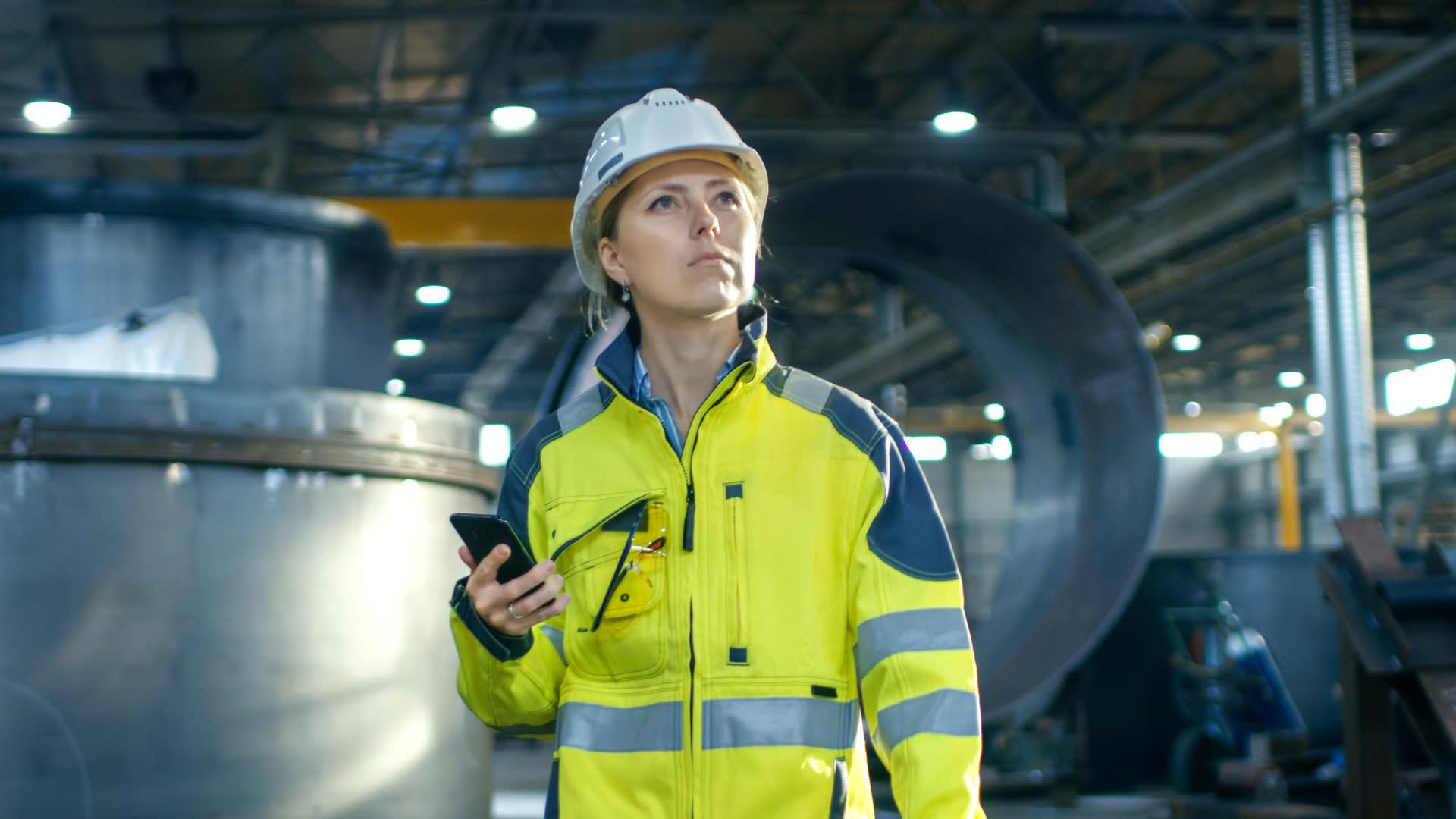 Woman in hard hat in factory
