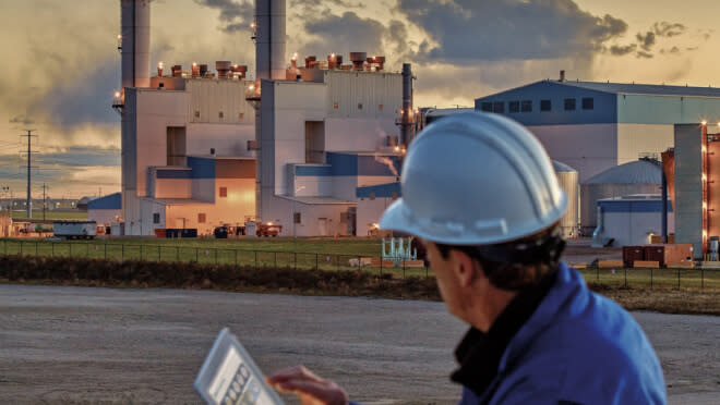 Man on tablet checking SSE Virtual Power Plant