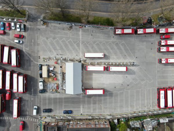 Buses in a bus depot.