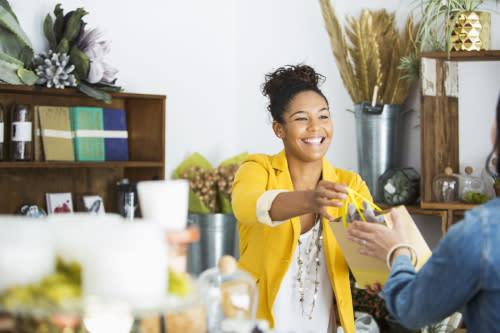 Shop worker serving customer