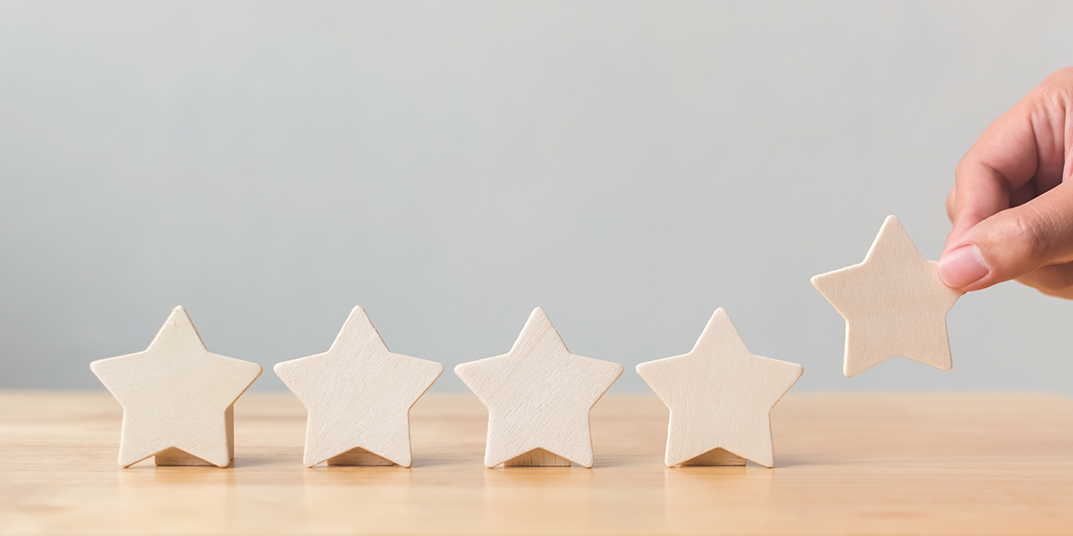 5 wooden stars on a table