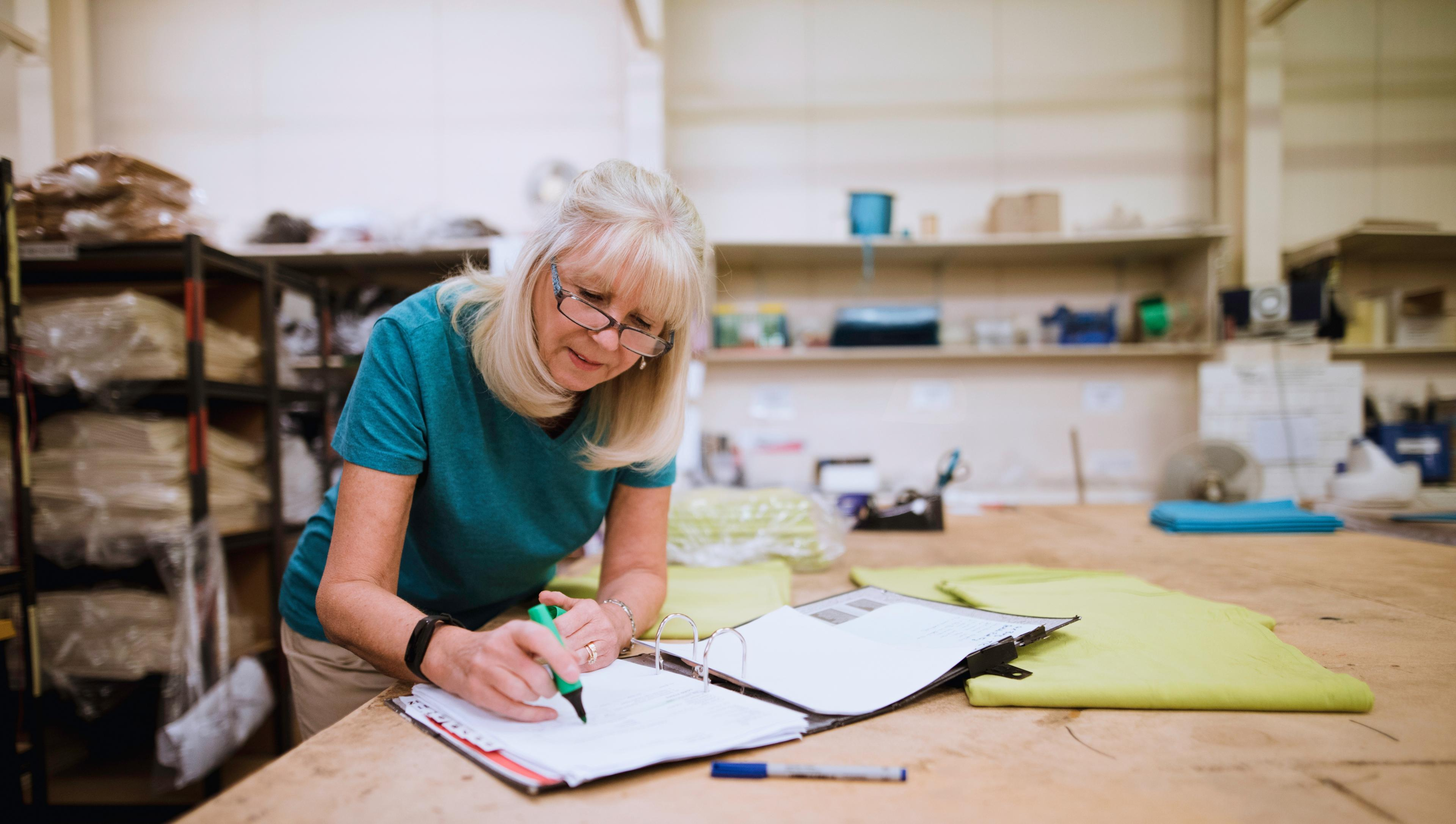 Woman doing accounts in workshop