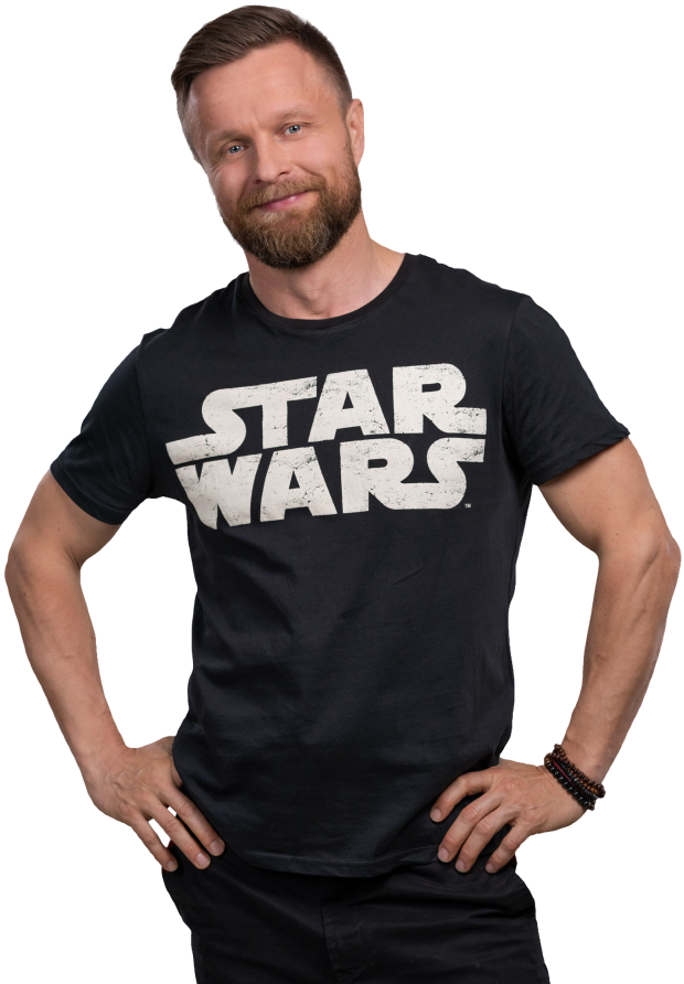 A man with star wars shirt smiling