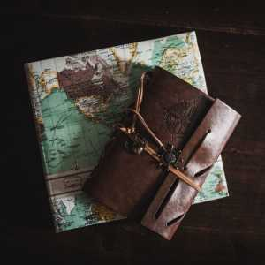 A map and travel journal on a black background
