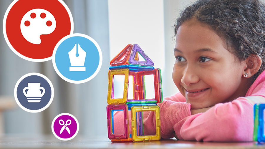 a child looking at a tower created from magnetic blocks with floating arts and crafts clipart images