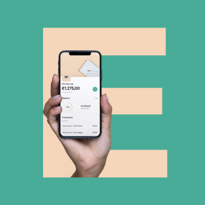 Hand holding a smartphone with the letter E in the background.