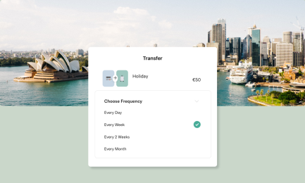 A screenshot of a Transfer UI on the N26 app overlaid on top of an aerial photo of Sydney.