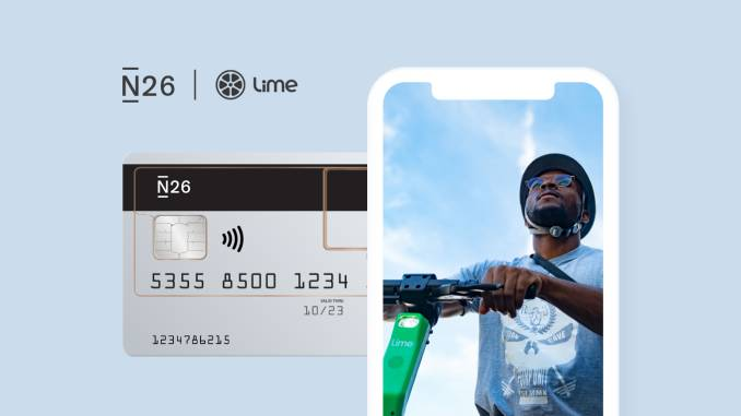 N26 card, app, and person riding an electric scooter.