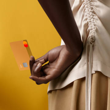 A person holding a Sand colored N26 You card behind their back.