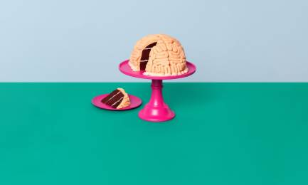Money worries are weighing on our minds image with a brain cake on a pink stand.