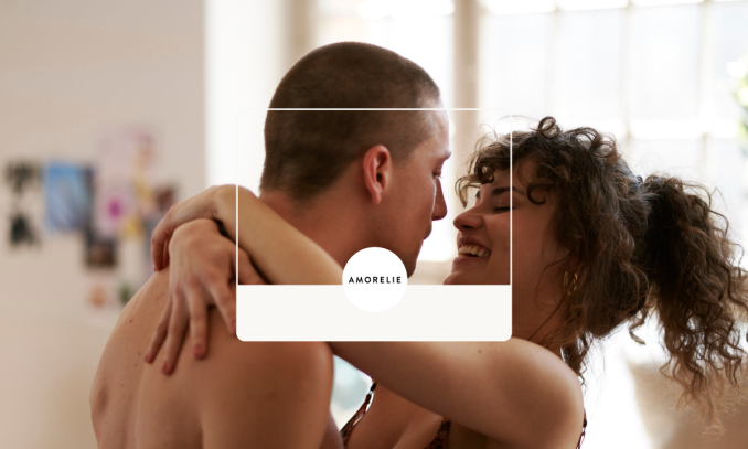 Two people embracing with the Amorelie logo at the front.