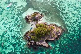 An aerial view of a small, uninhabited island.