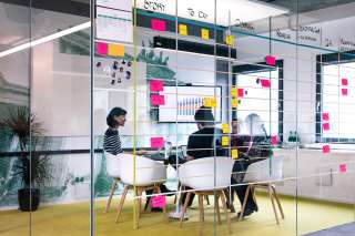 A view of a meeting room through its glass walls, at the N26 Berlins, Mitte location