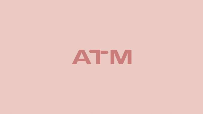 "A text ""ATM"" against a read background."