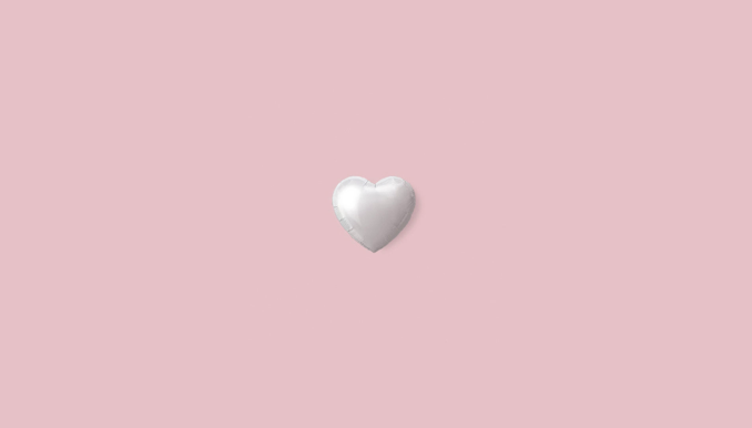 Heart balloon on pink background.