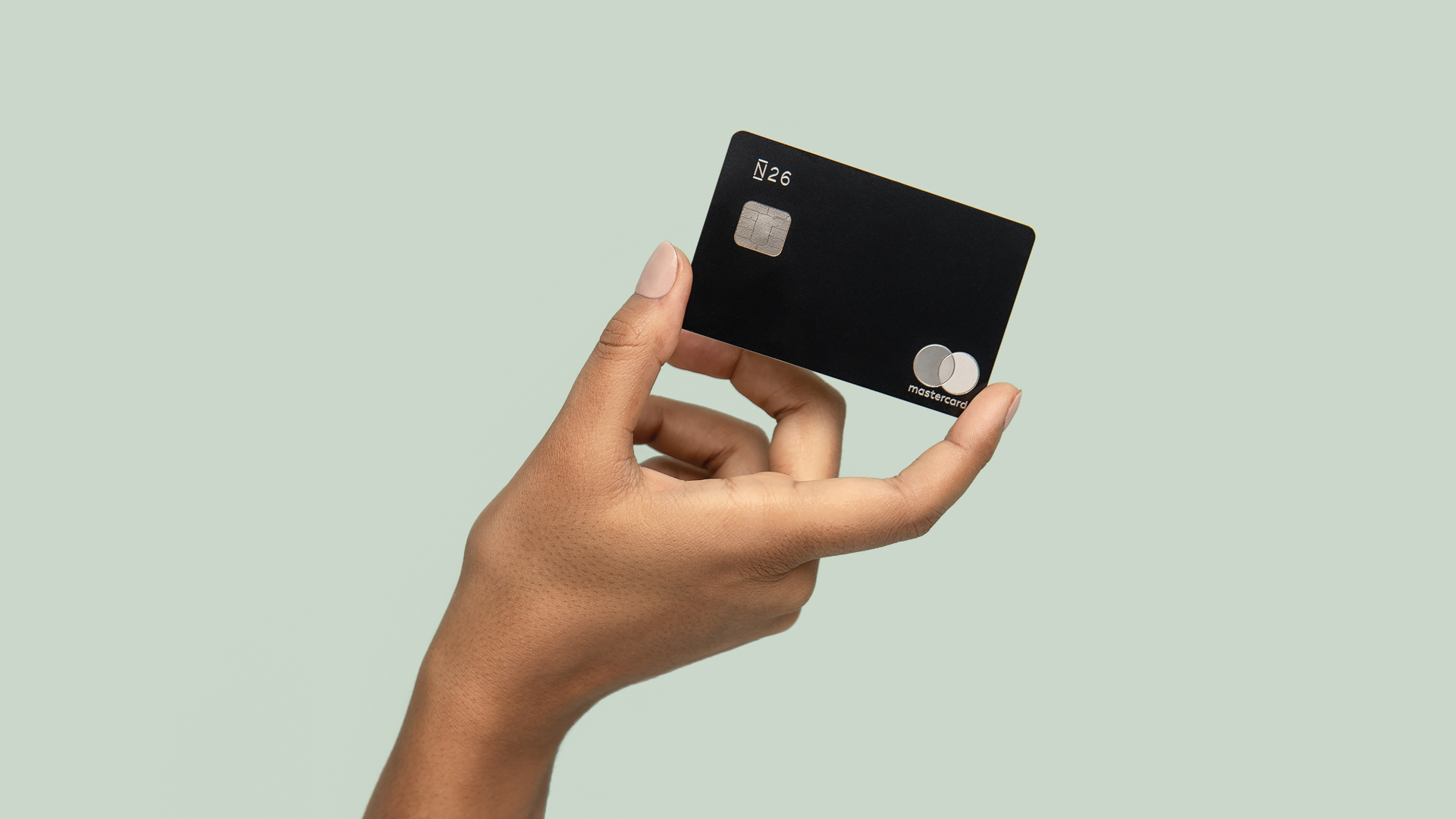 N26 Press Image of our 26 reasons campaign with a hand holding a premium charcoal black metal card
