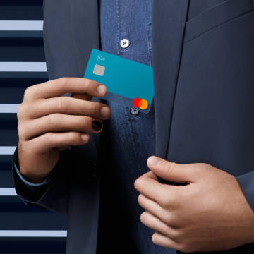 A person taking out an Ocean colored N26 You card from their jacket inner pocket.