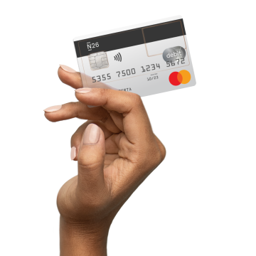 A hand holding the Standard N26 card.