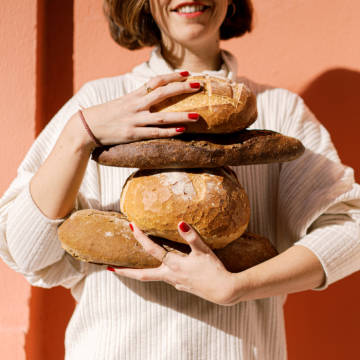 Small business owner woman with bread.