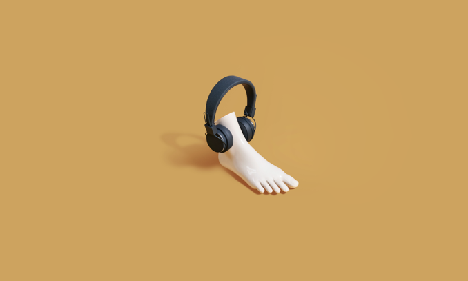 A fake plastic feet wearing a black headphone speaker.