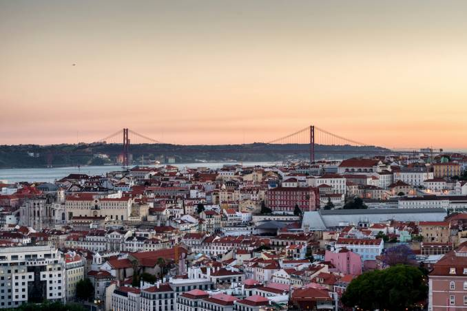 picture of a sunset in lisbon and Tagus river.