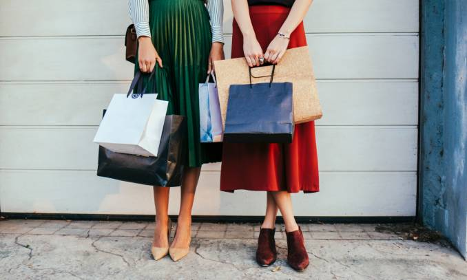 Two women with shopping bags.