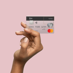 Hand holding a N26 business debit card.
