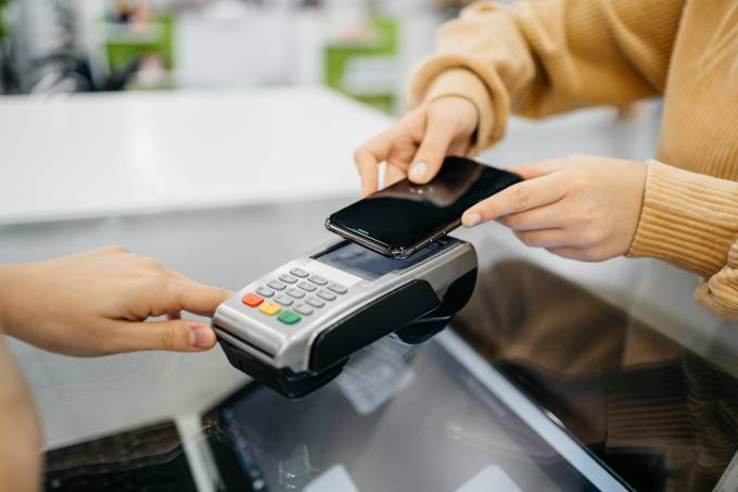 woman paying with her smartphone in a store.