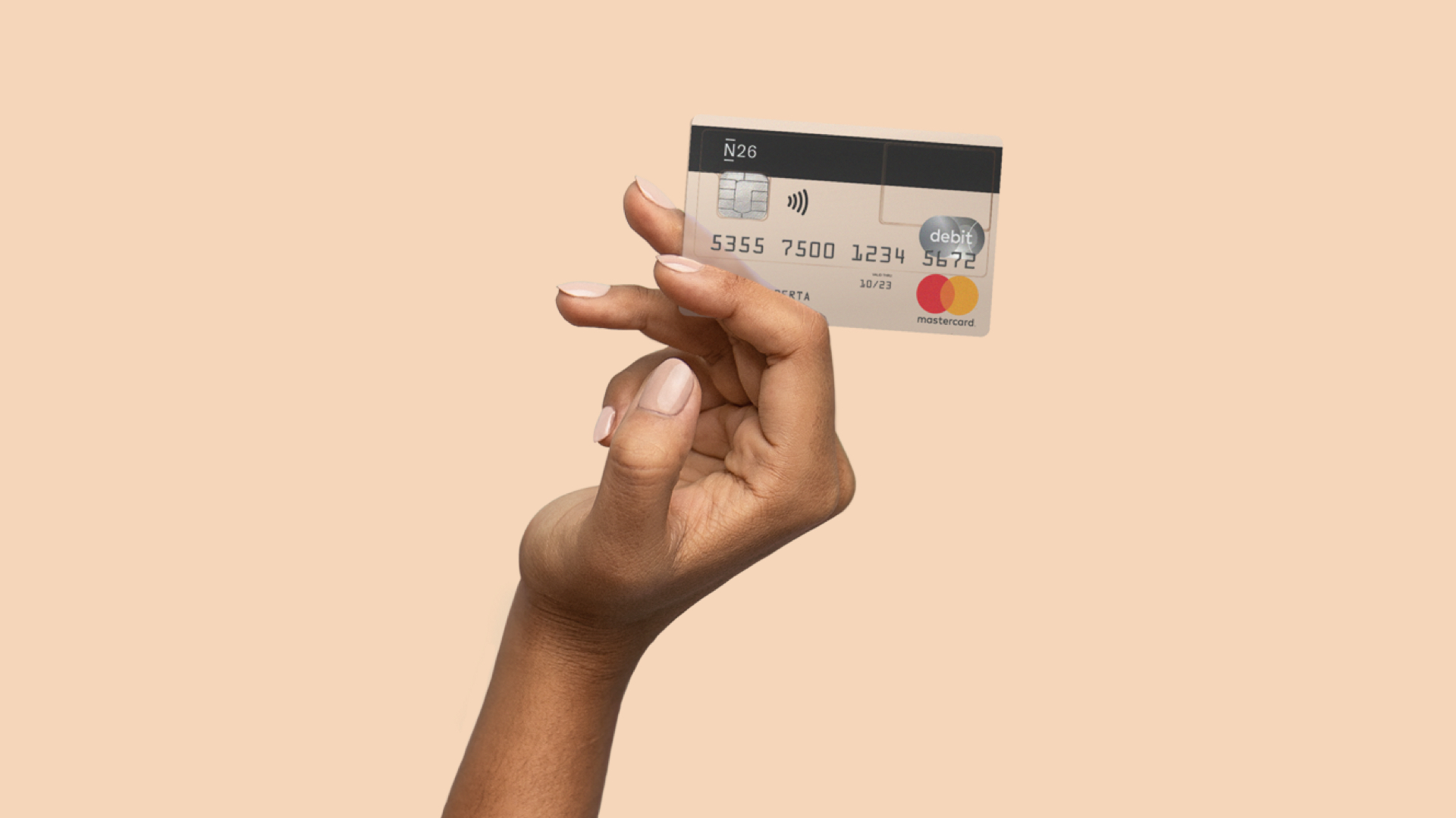 N26 Press Image of our 26 reasons campaign with a hand holding a free bank account mastercard debitcard