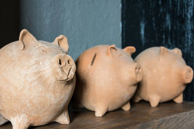 three porcelain piggy banks.
