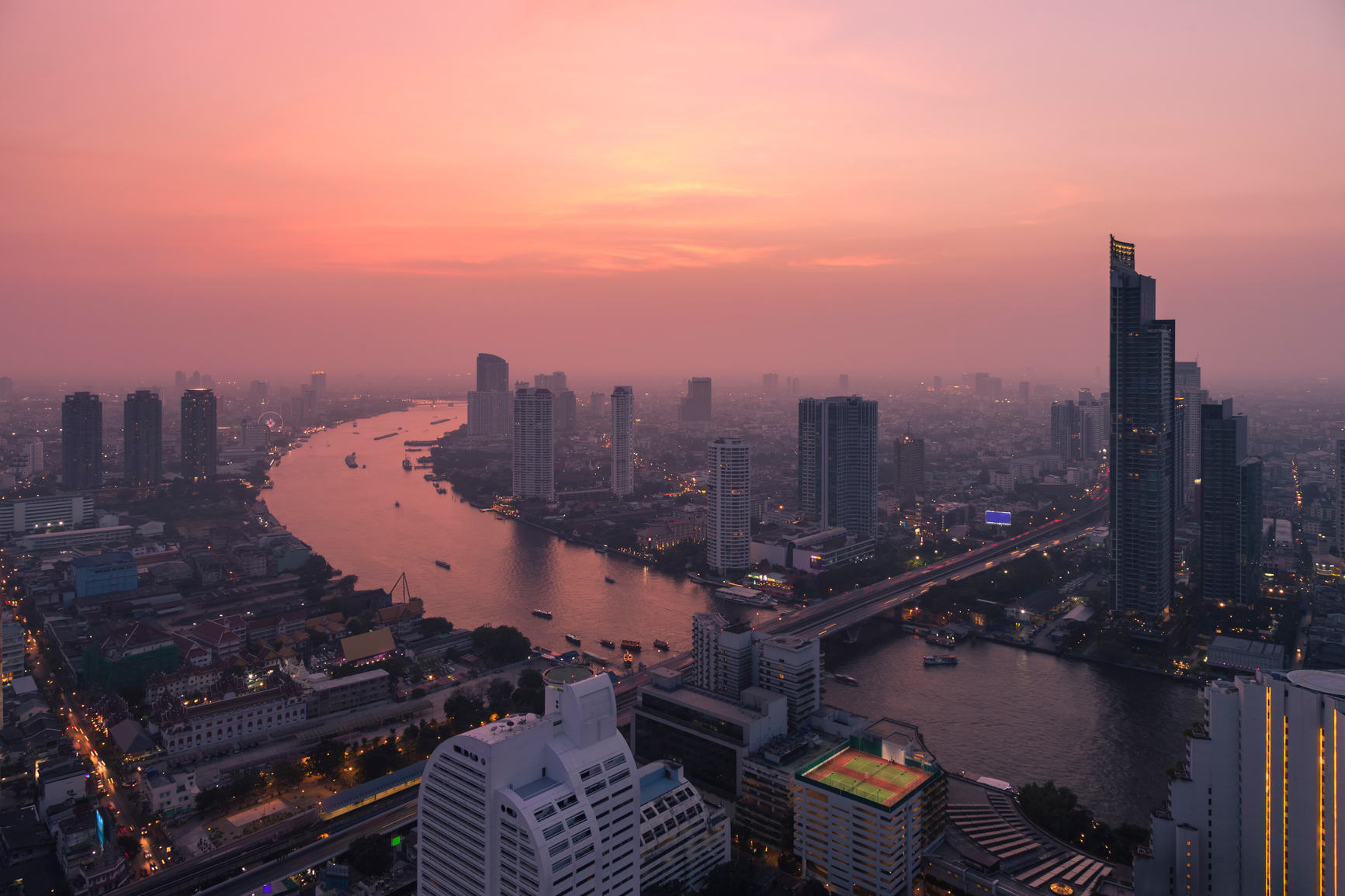 Evening Panorama Of Bangkok, Thailand With The Chao Phraya River