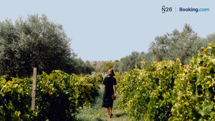 Woman walking in a vineyard.