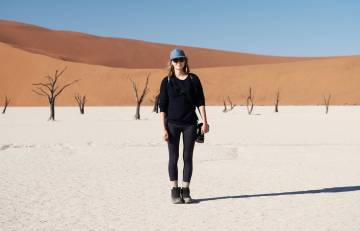 A person standing in a desert.