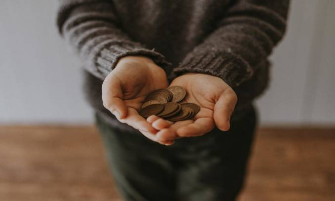 Hands holding some coins.