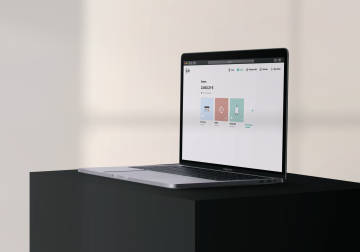 Laptop with desktop version of N26 on a black table.