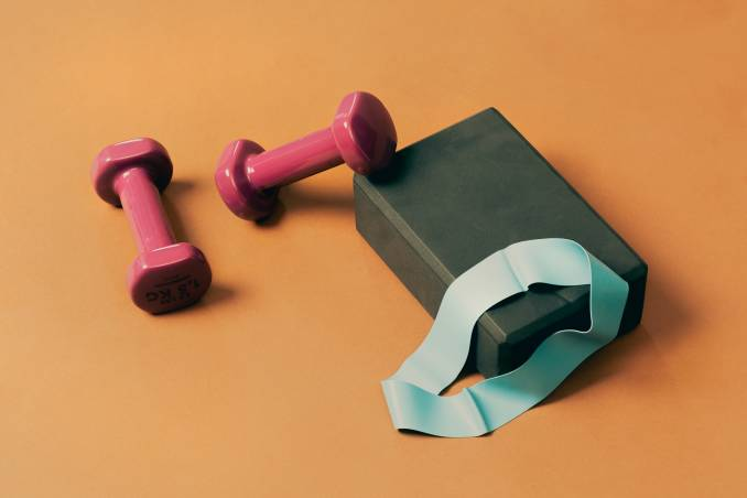 Gym equipment on orange background.