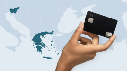 N26 Metal card held by an elevated hand with map of Europe in the background.
