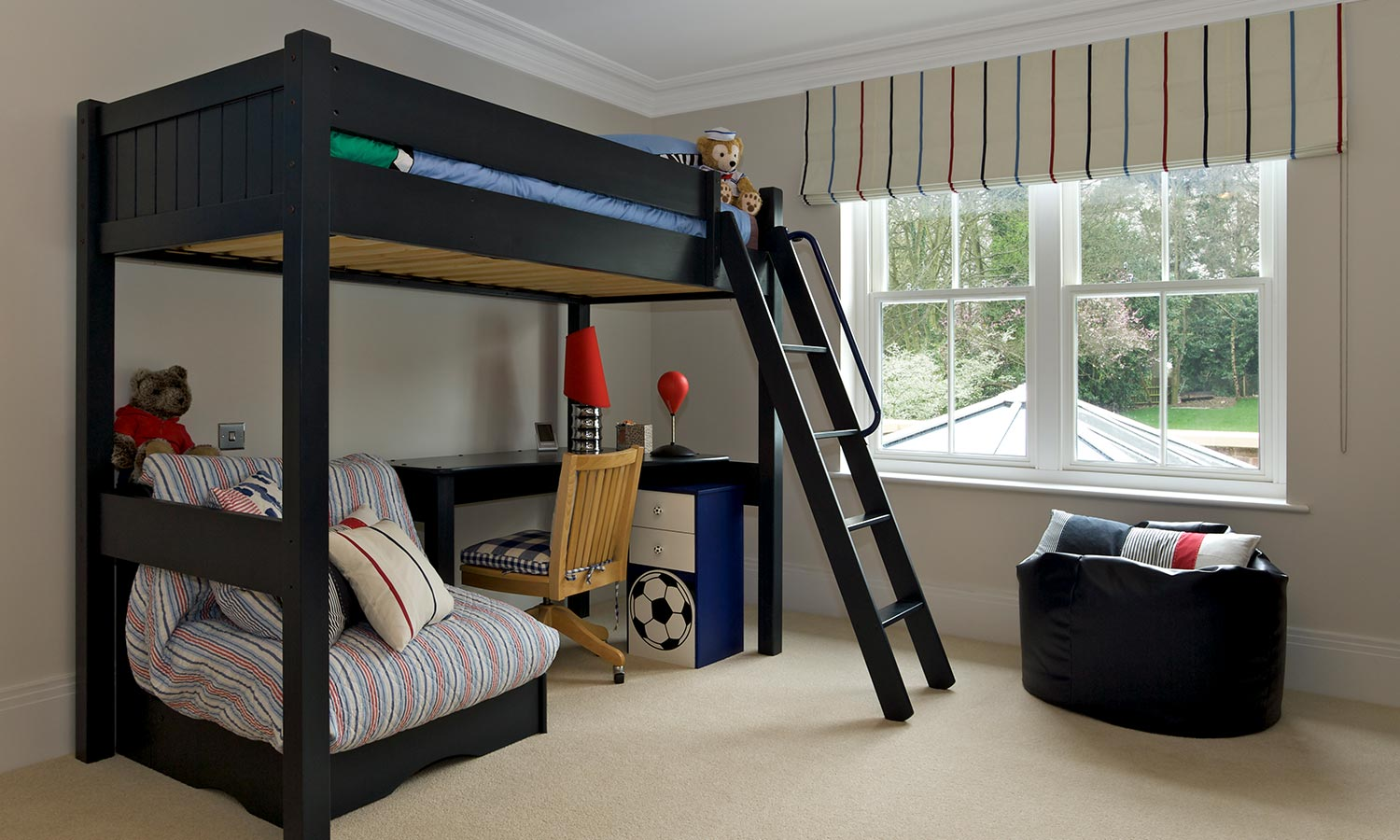 A lofted bunk bed with desk underneath