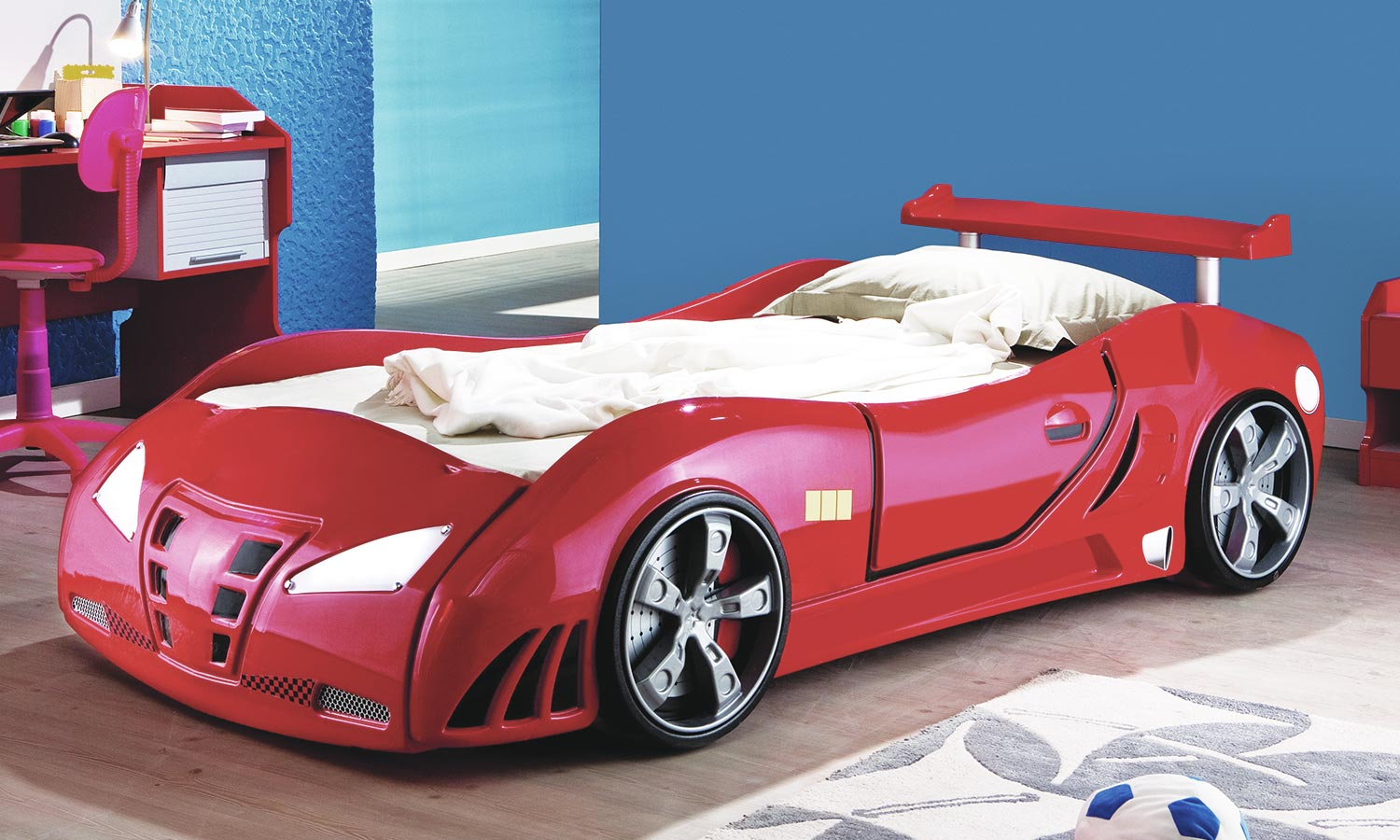 A small children's bed shaped like a car
