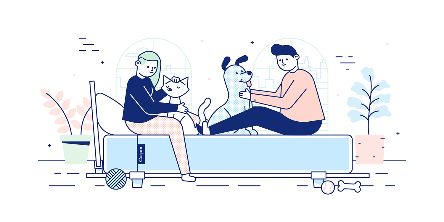 A couple sits on their California King-size bed while playing with two dogs. Illustration.