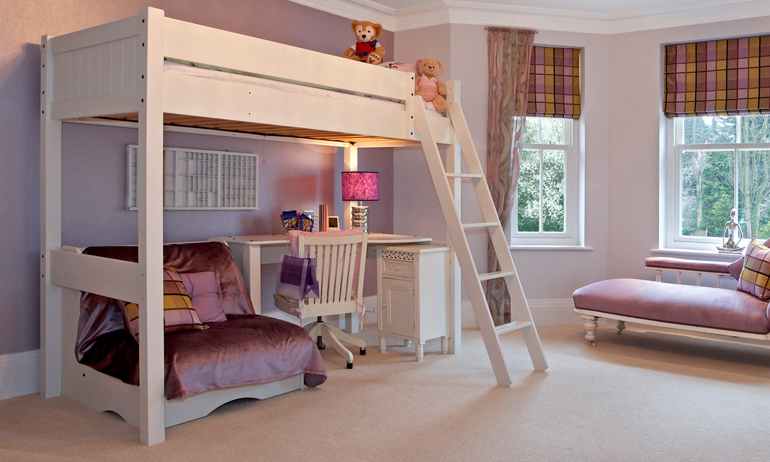 A lofted bed with a play area underneath