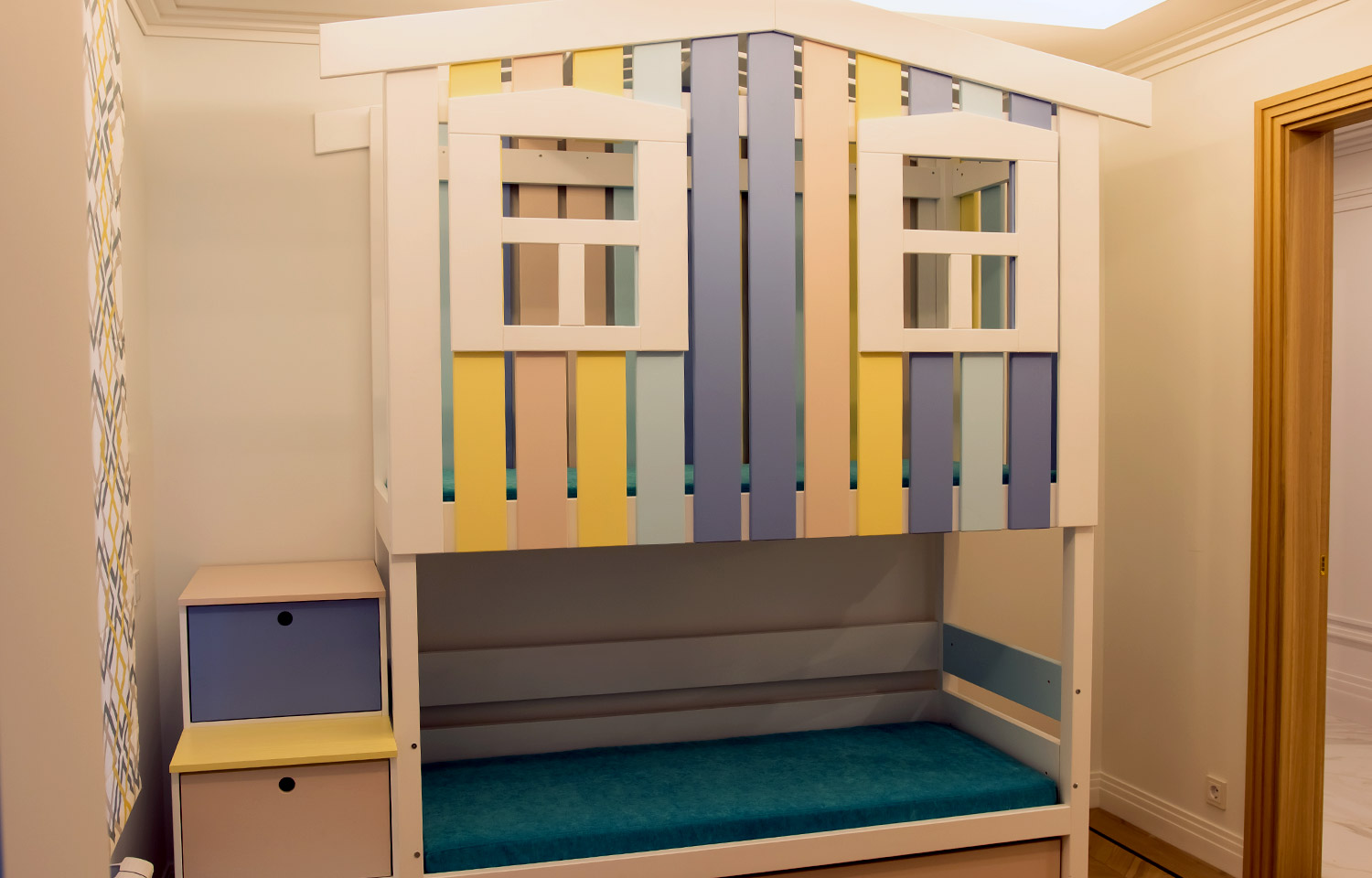 A bed with a tall cabin-shaped canopy. The canopy has a slatted wooden exterior with windows.