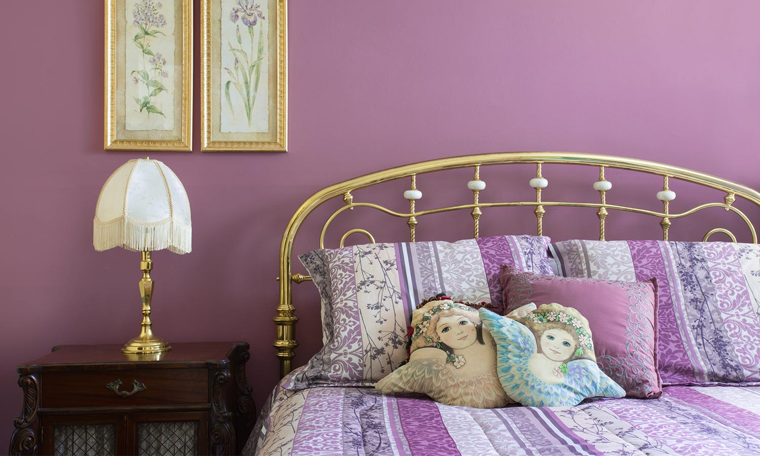 A rounded brass headboard and frame