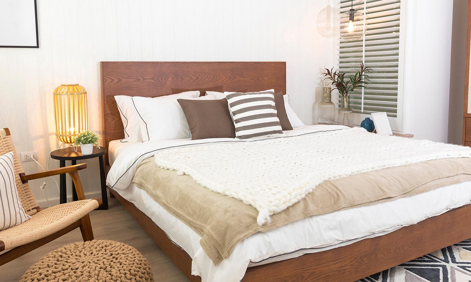 A wooden bed frame with a tall headboard.