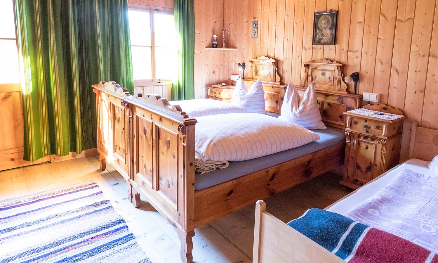 A bed made of un-stained, rustic wood