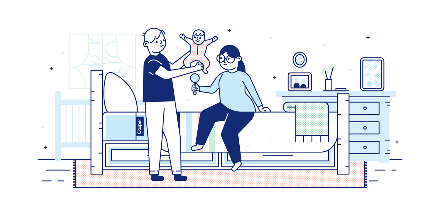 A couple lounges near a king-size mattress while playing with their baby. Illustration.