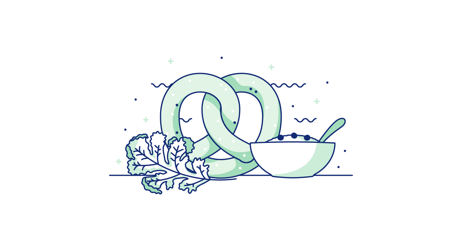 Pretzels, oatmeal, and kale spread out onto a table. Illustration